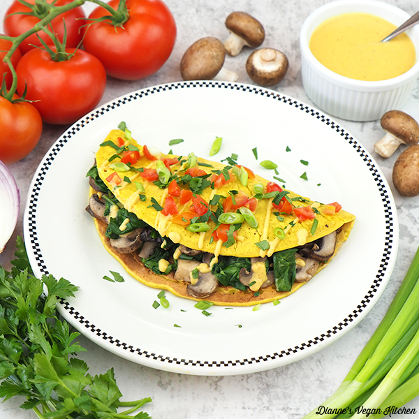 chickpea omelet with tomatoes, mushrooms, and cheese sauce—square