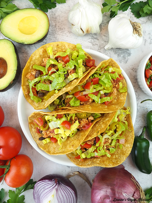 tacos with avocado, garlic, salsa, tomatoes, onion, and peppers