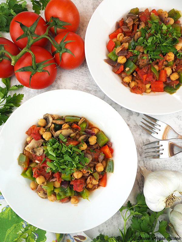 two bowls of chickpea cacciatore with tomatoes and garlic