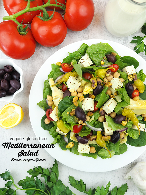 salad with tomatoes, olives, and lemon with text overlay