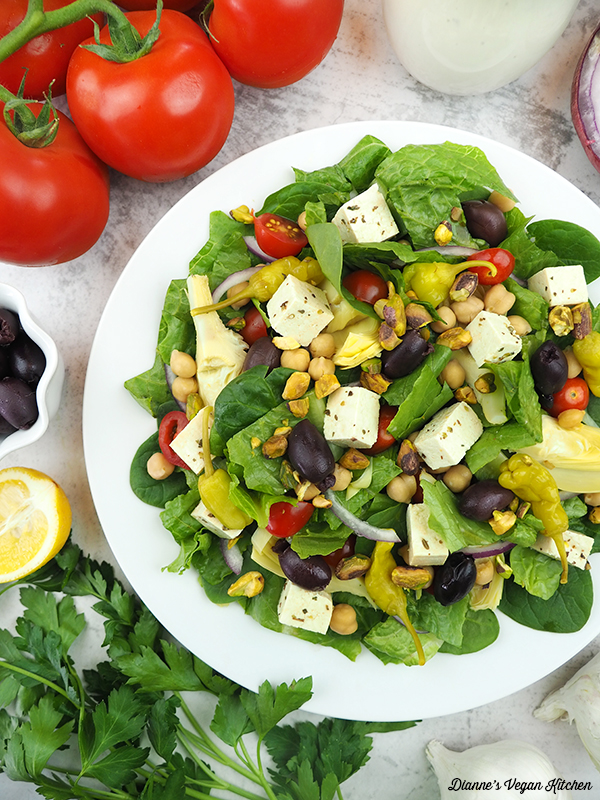 Mediterranean Salad with tomatoes, olives, dressing, and lemon
