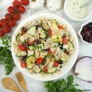 Vegan Greek Pasta Salad with tomatoes, garlic, onion, tahini, olives, and parsley square