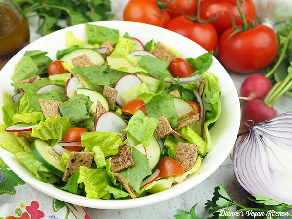 salad with tomatoes, onion, and radishes - horizontal