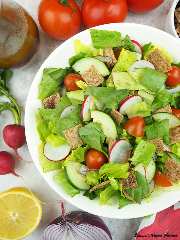salad with radishes, tomatoes, lemon, and onion