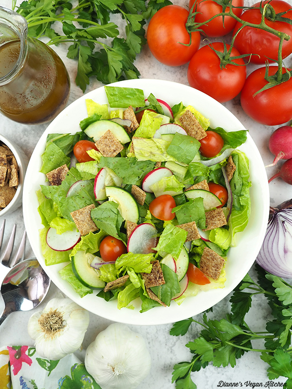 salad overhead with dressing, tomatoes, radishes, and onion