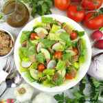 salad with onion, radishes, garlic, dressing, and tomatoes - square