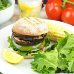 Grilled Eggplant Sandwich on plate with corn on the cob and salad