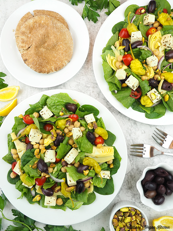 two Mediterranean Salads with pita and olives