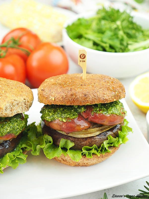 Grilled Portobello Sandwiches with salad, corn on the cob, and tomatoes