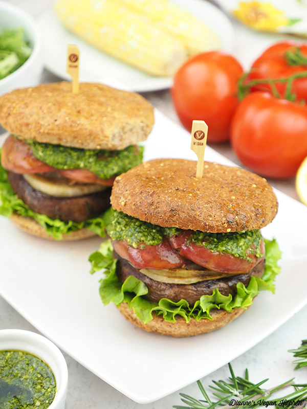 two Grilled Portobello Sandwiches with corn on the cob and tomatoes