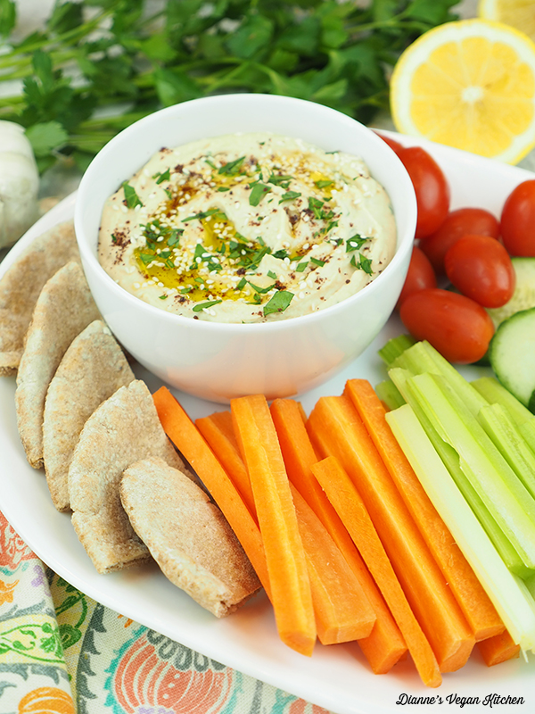 dip on platter with vegetables and pita
