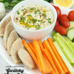 Garlicky White Bean Dip with vegetables with text overlay