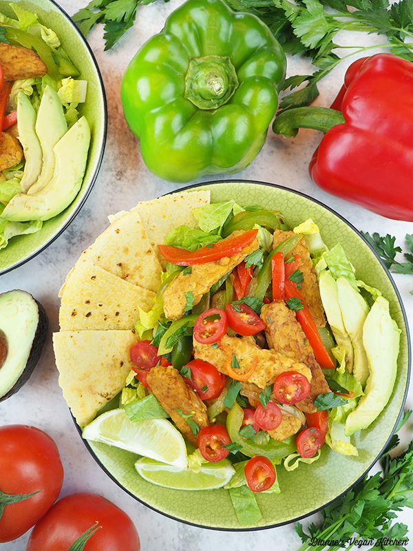 two fajita salads with peppers and tomatoes