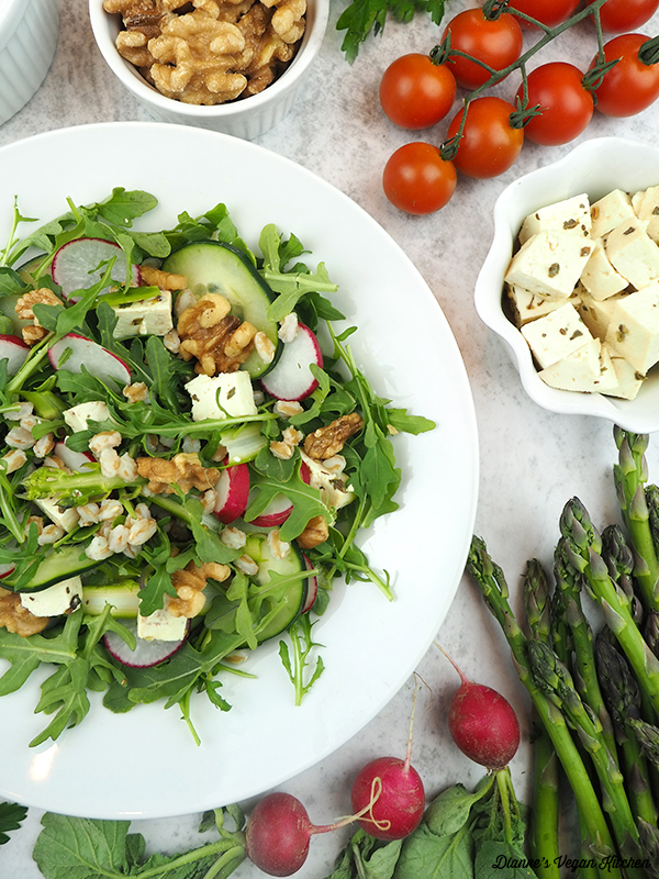 Asparagus and Arugula Farro Salad plate with asparagus, feta, and tomatoes