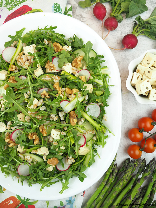 platter of salad with radishes, feta, tomatoes, and asparagus