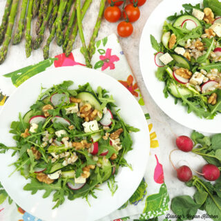 two bowls of salad with asparagus, radishes, and tomatoes square
