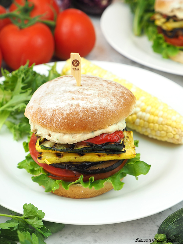 sandwich on plate with corn on the cob and lettuce