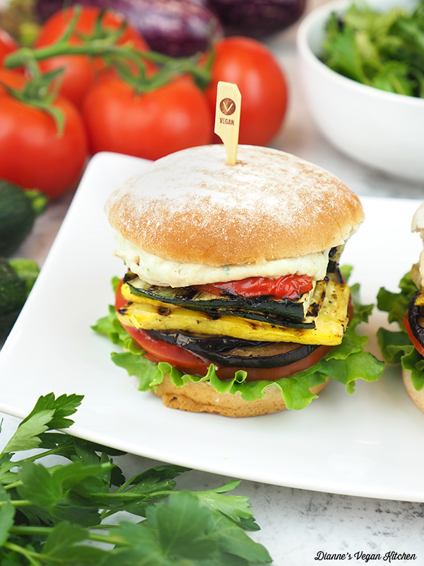 grilled ratatouille sandwich with tomatoes and bowl of lettuce