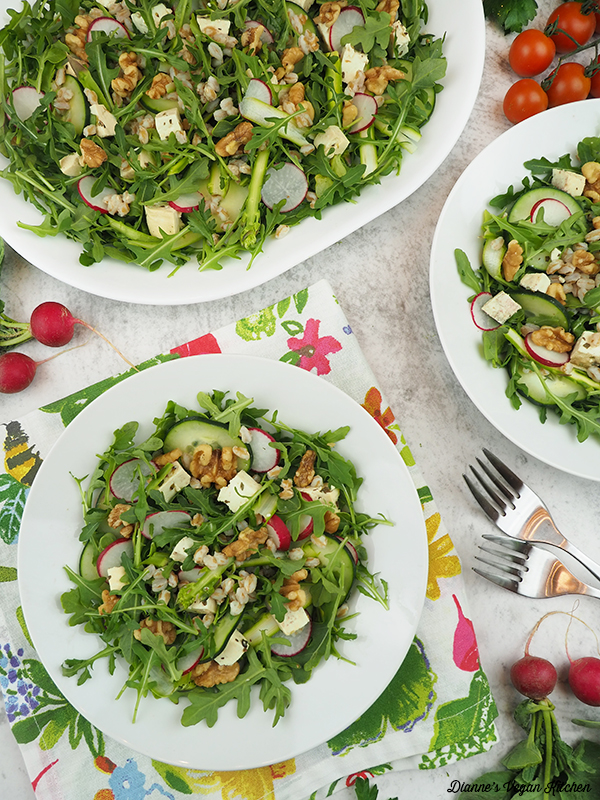 two bowls of salad with salad platter