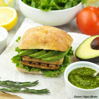 grilled tofu sandwich with avocado and pesto, square