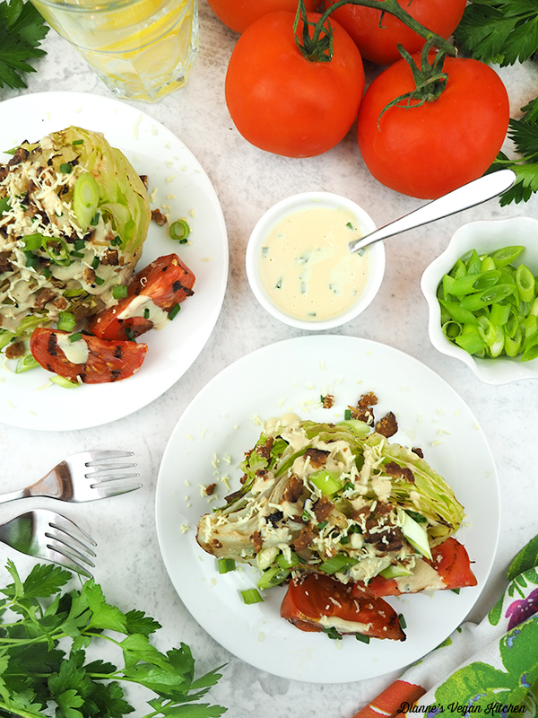 two Grilled Wedge Salads overhead with tomatoes, scallions, and dressing