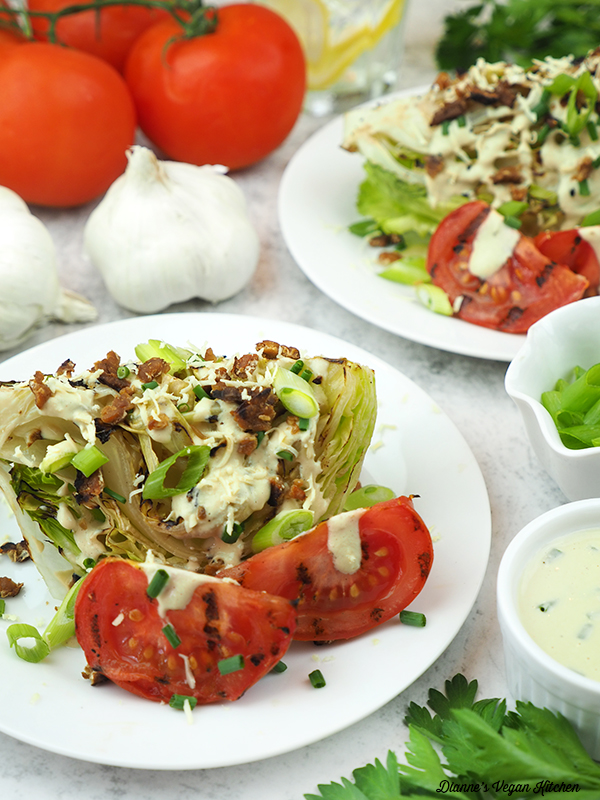 two salad with tomatoes, garlic, and dressing