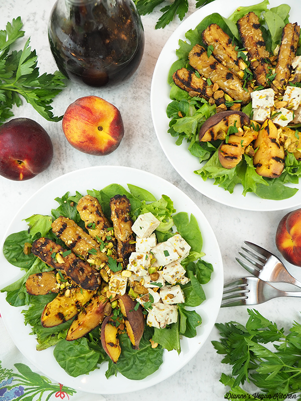 overhead of two bowls of salad with peaches