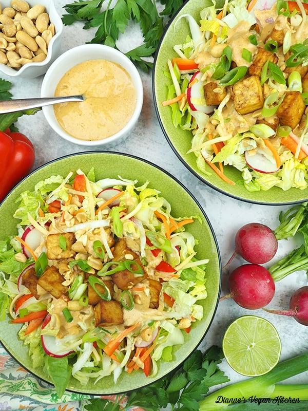 pad thai salads with radishes, limes, pepper, scallions, peanuts, peanut dressing