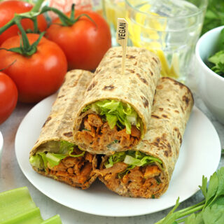 stack of Buffalo Soy Curl Wraps with tomatoes and salad