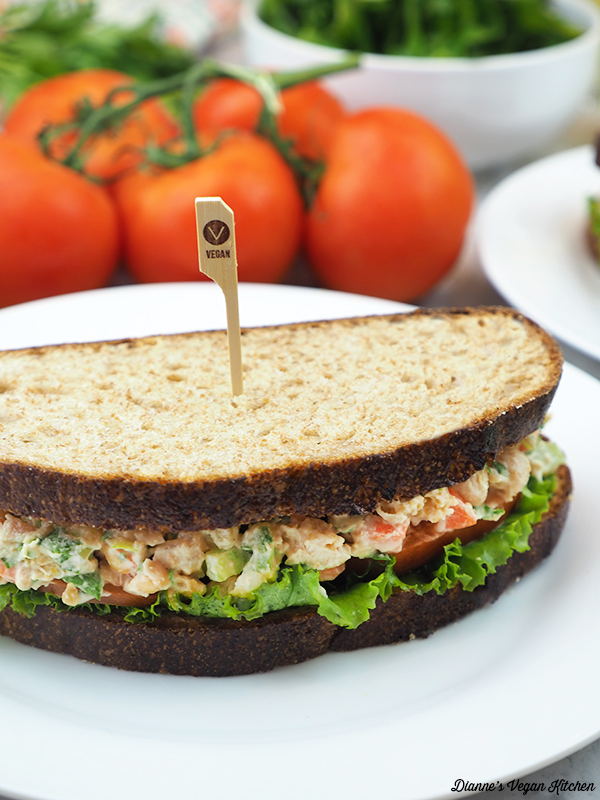 close up of chickpea sandwich with tomatoes and salad