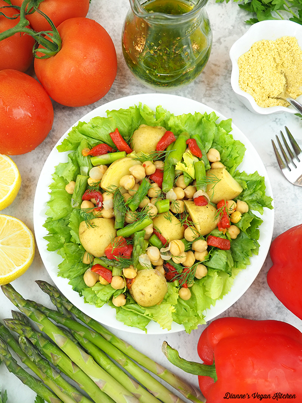 escarole salad with asparagus, tomatoes, peppers, parmesan, and dressing