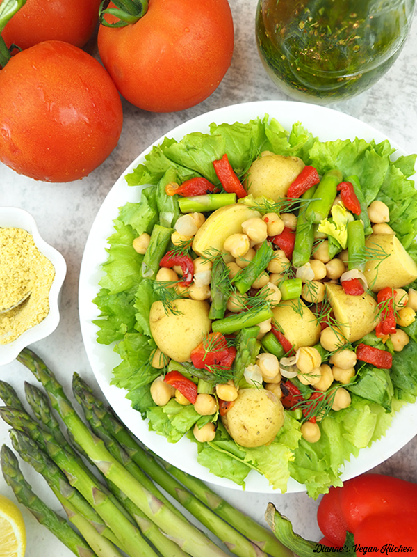 escarole salad with asparagus, tomatoes, and dressing