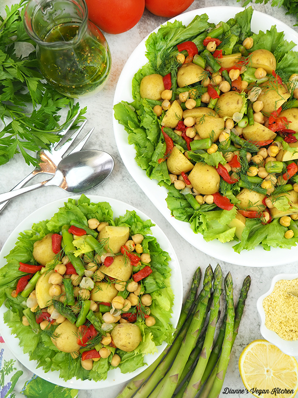 escarole salad with asparagus, dressing, lemons, and tomatoes