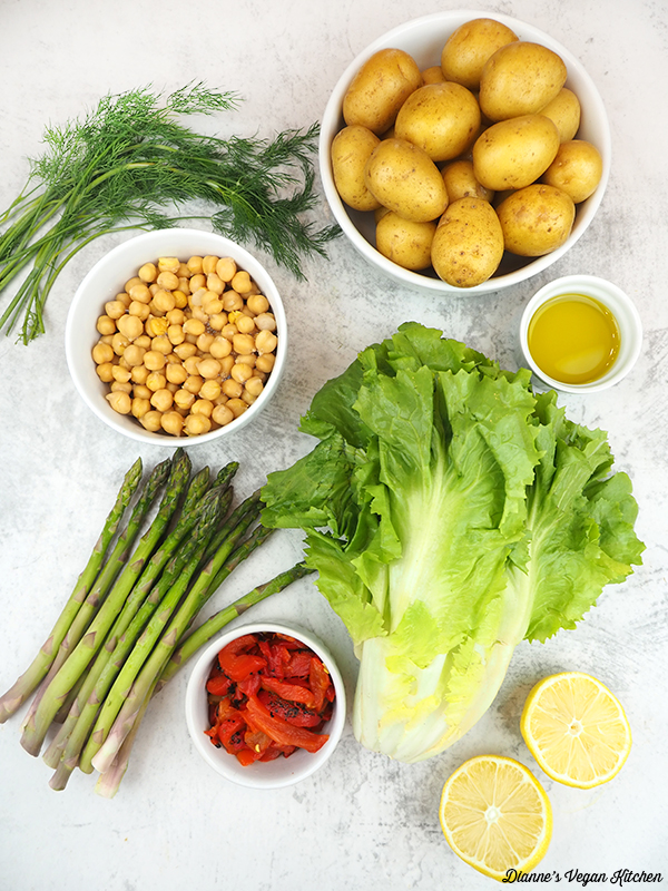 dill, potatoes, escarole, asparagus, roasted red peppers, olive oil, lemons, and chickpeas