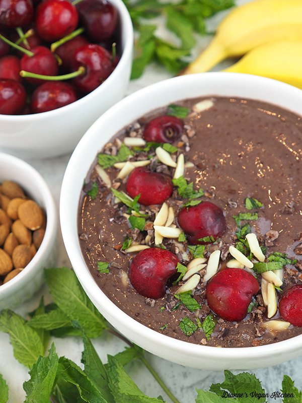 smoothie bowl with bananas, cherries, mint, and almonds