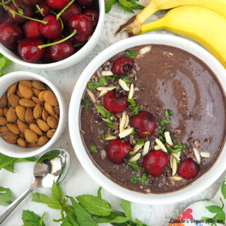 Cherry Smoothie Bowl with text overlay with cherries, almonds, banana, and mint