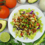 taco salad with avocado, lime, and tomatoes, square