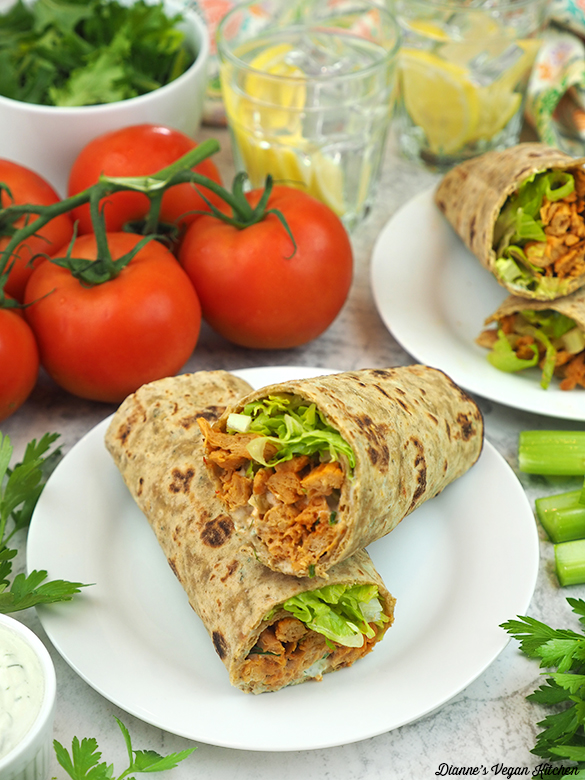 two lates of wraps with salad and tomatoes