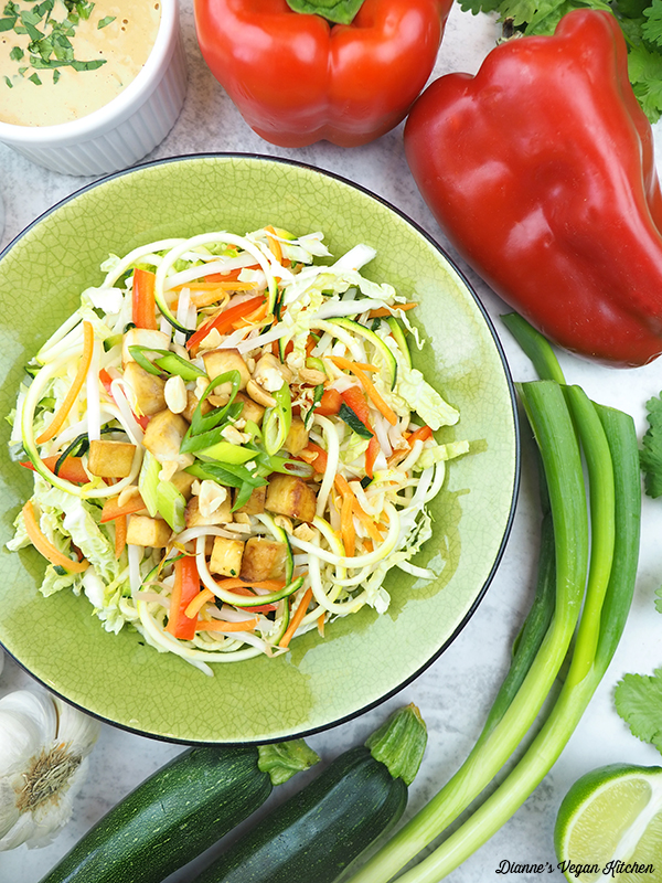 one bowl of pad thai zoodles with zucchini, scallions, peppers, and peanut sauce