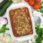pan of Vegan Zucchini Lasagna with tomatoes, zucchini, onion, garlic, and mushrooms