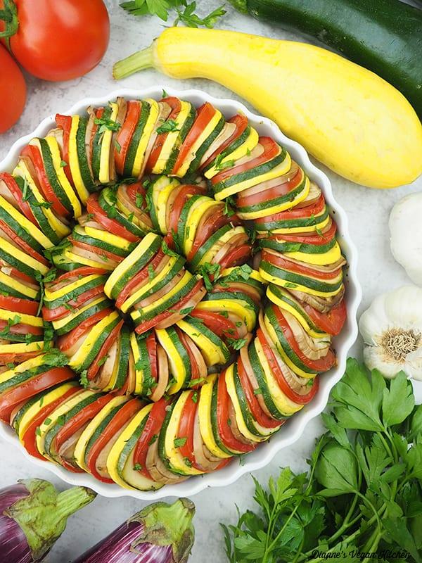 Baked Ratatouille with tomatoes, garlic, parsley, eggplant, squash, and zucchini