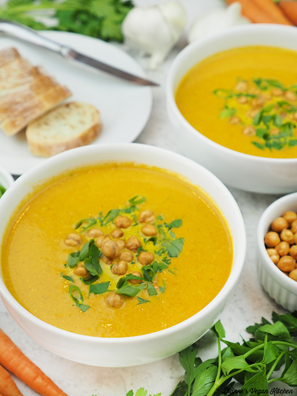 soup with bread, carrots, chickpeas, and parsley