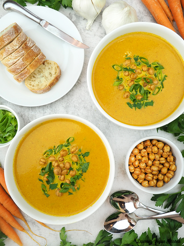 Curried Carrot Soup with bread, chickpeas, scallions, carrots, and parsley