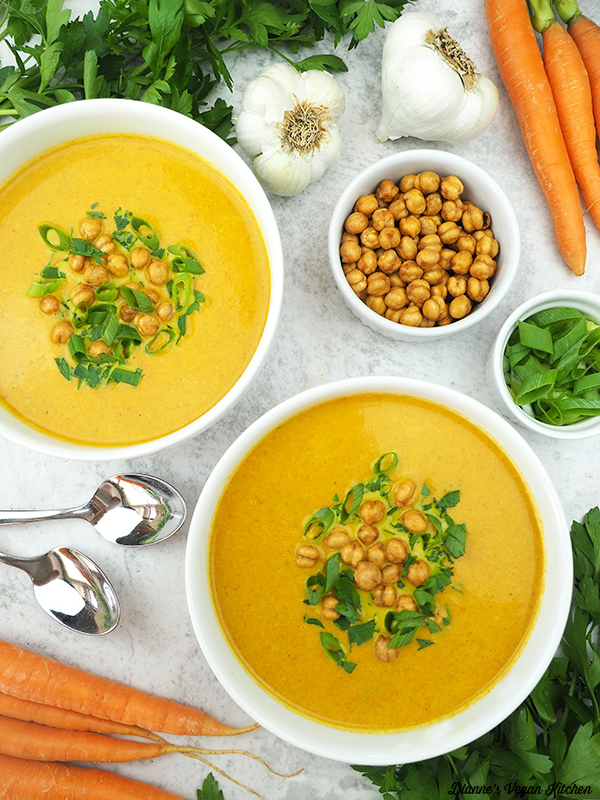 curried carrot soup with chickpeas, scallions, garlic, and carrots