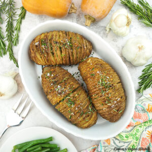 Hasselback Potatoes with squash, green beans, rosemary, and garlic