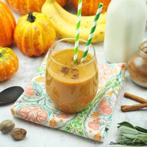 two Pumpkin Pie Smoothies with almond milk, nutmeg and cinnamon sticks