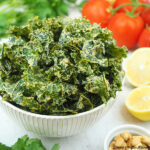 Cheesy Kale Chips with tomatoes and lemon square