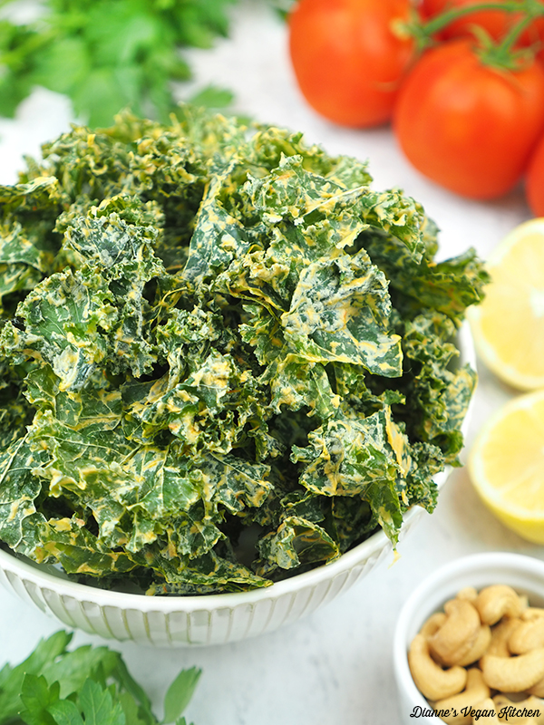 Cheesy Kale Chips with tomatoes, lemon, and cashews