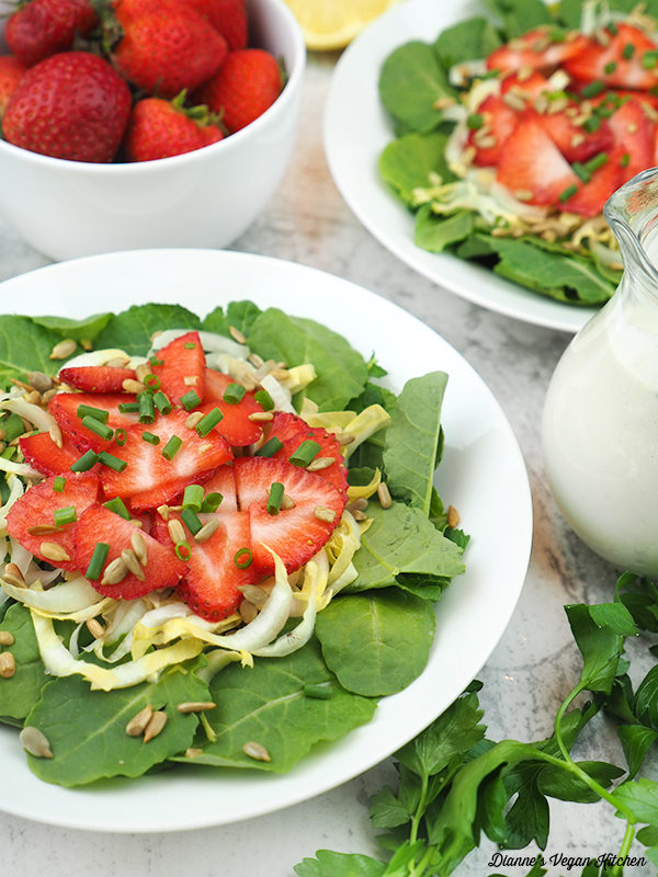 strawberry kale salad with strawberries and dressing